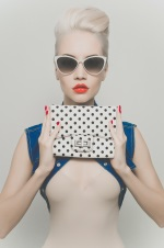 girl holding a polka dot purse