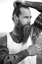 black and white tattooed bearded man