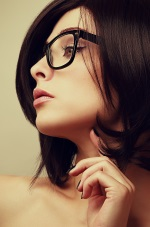 brunette with glasses looking sideways