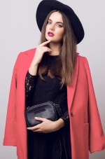 girl in black hat and peach blazer