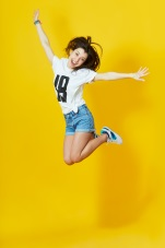 girl jumping with yellow background