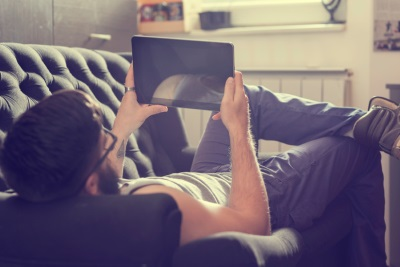 guy on couch with ipad