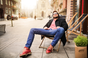 man relaxing on city street