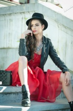 girl in a red dress with a leather jacket and hat